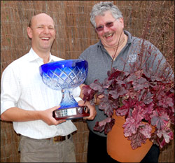 Patrick Fairweather, director of Aline-Fairweather joins Dan Heims, president of TERRA NOVA® Nurseries to cheer the success of Heuchera 'Midnight Rose'